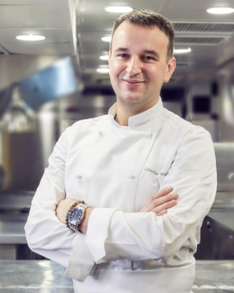 Chef Sebastien Lepinoy in kitchen.jpg