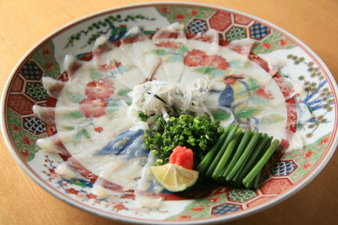 Fugu sashimi is often served with chives and radish grated with chilli.
