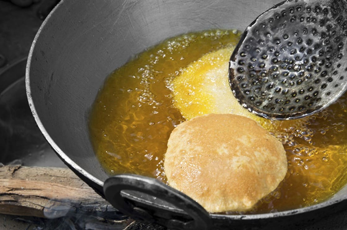 Frying the perfectly puffed puri is quite an art and science...