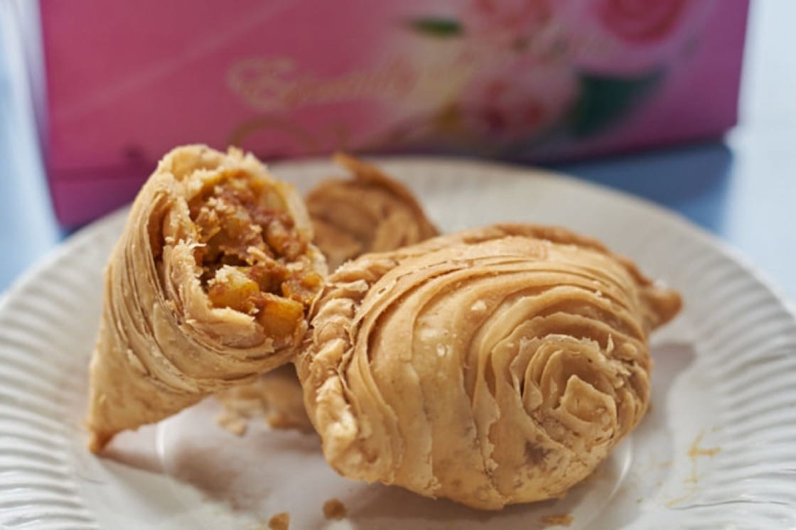 A generously stuffed curry puff encased in a flaky, crispy crust is typical of J2 Crispy Curry Puff