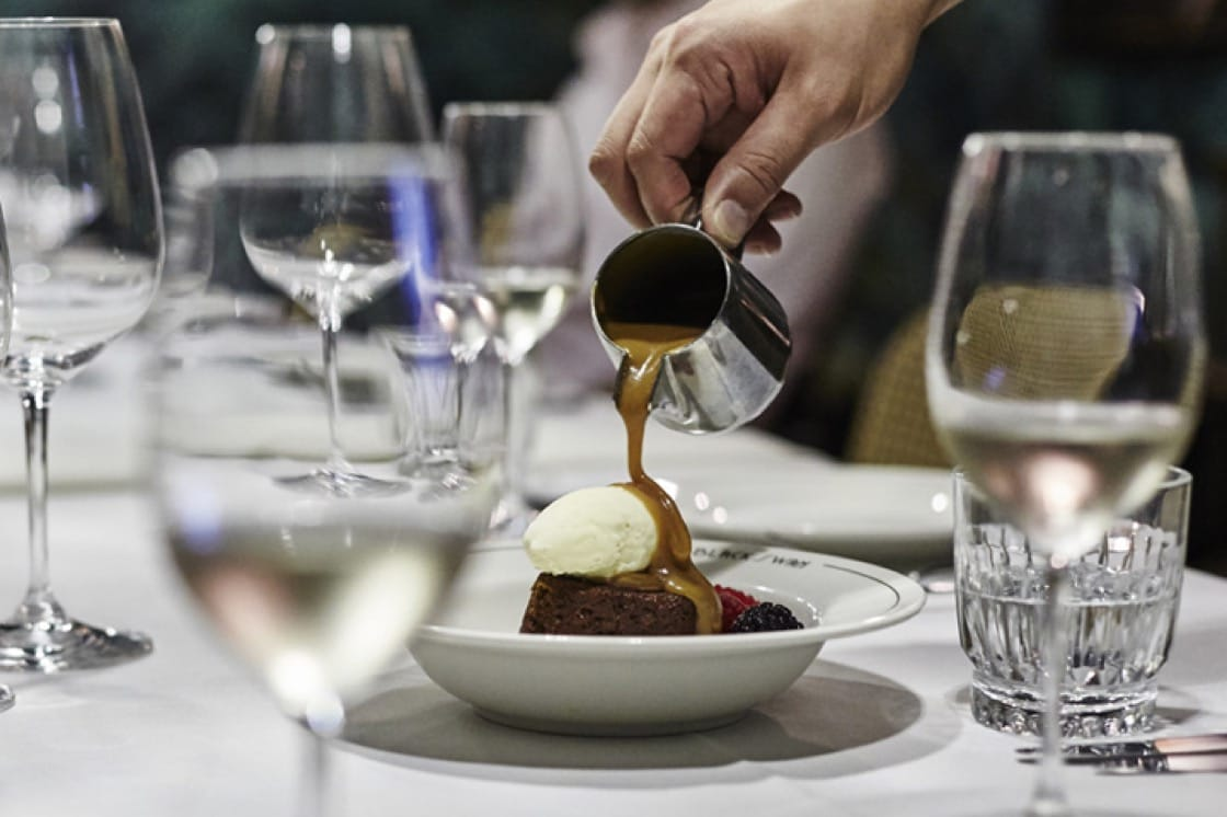The sticky date pudding with ice cream. Berries are serving suggestion. Photography: Wong Weiliang.