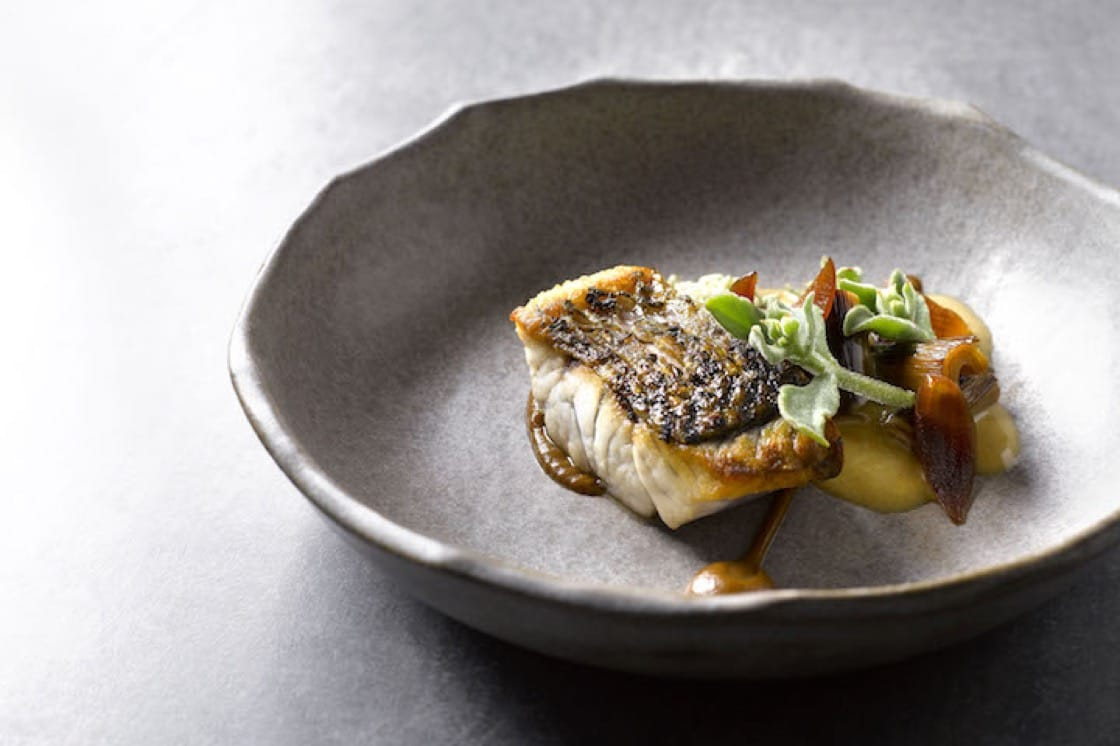 Barramundi with leeks, bonito butter and caramelised onion from new one-starred Australian restaurant Cheek by Jowl