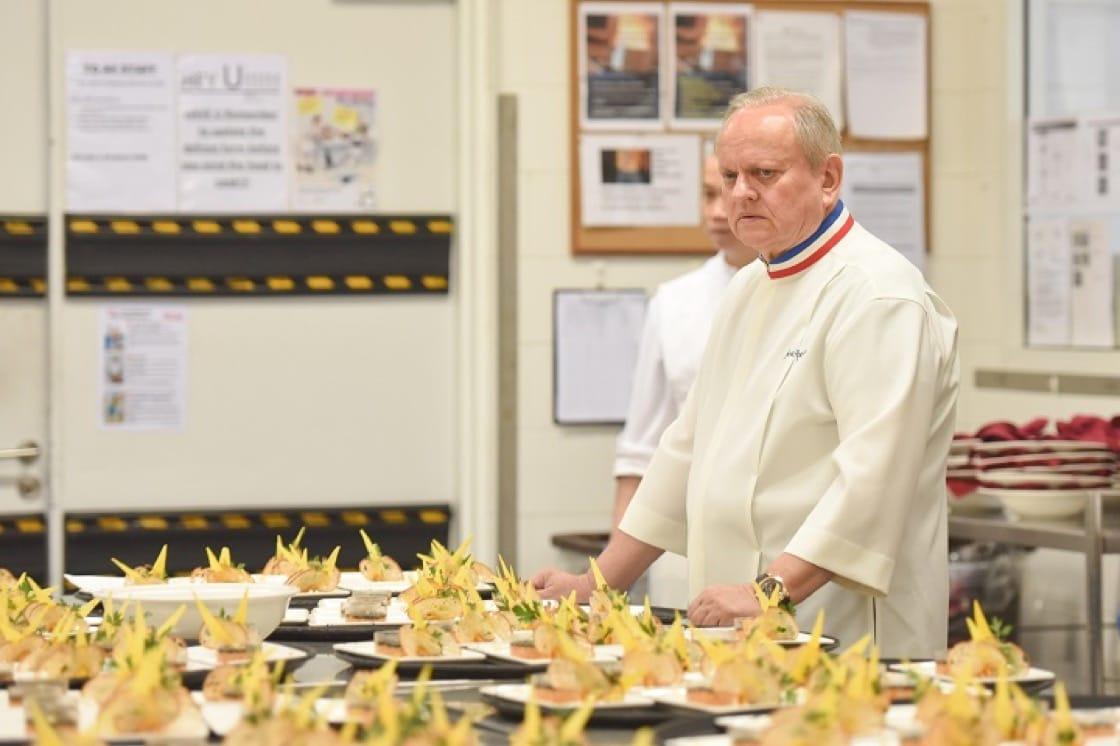 Chef Joel Robuchon scans through rows of amuse bouche.
