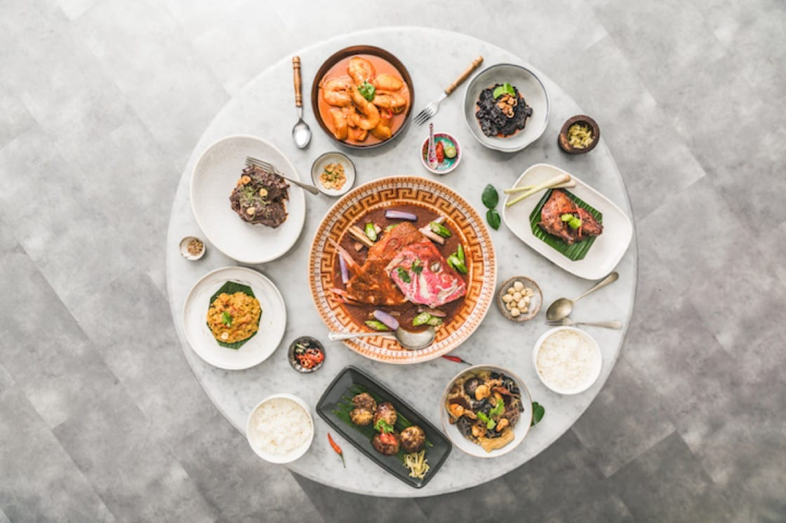 Family-style feast at Folklore, where the table is laden with heritage dishes such as garang assam, masak nanas and beef rendang.