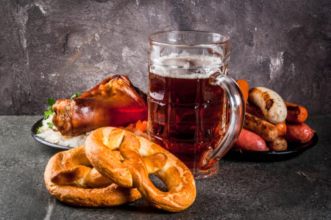 Typical fare at Oktoberfest includes a stein of Märzen, pretzels, pork knuckle and sausages.