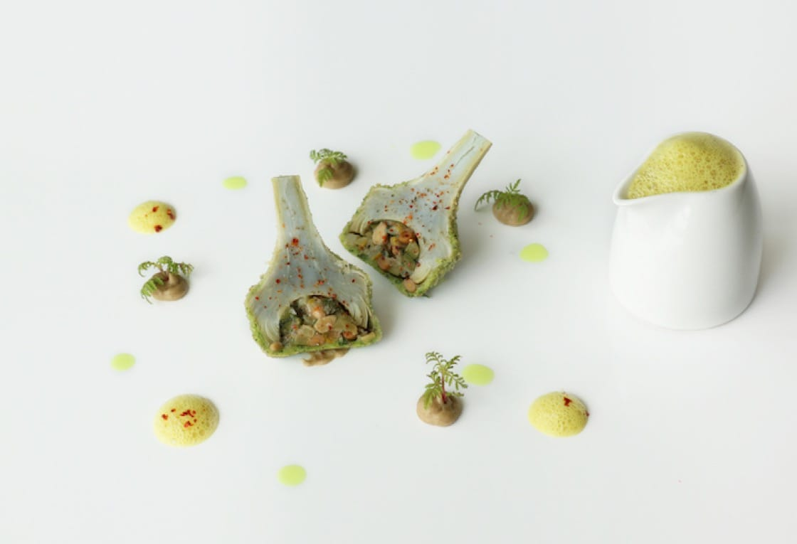 Herb-crusted purple artichoke, turmeric emulsion and marigold on the four-course children's menu at Saint Pierre.