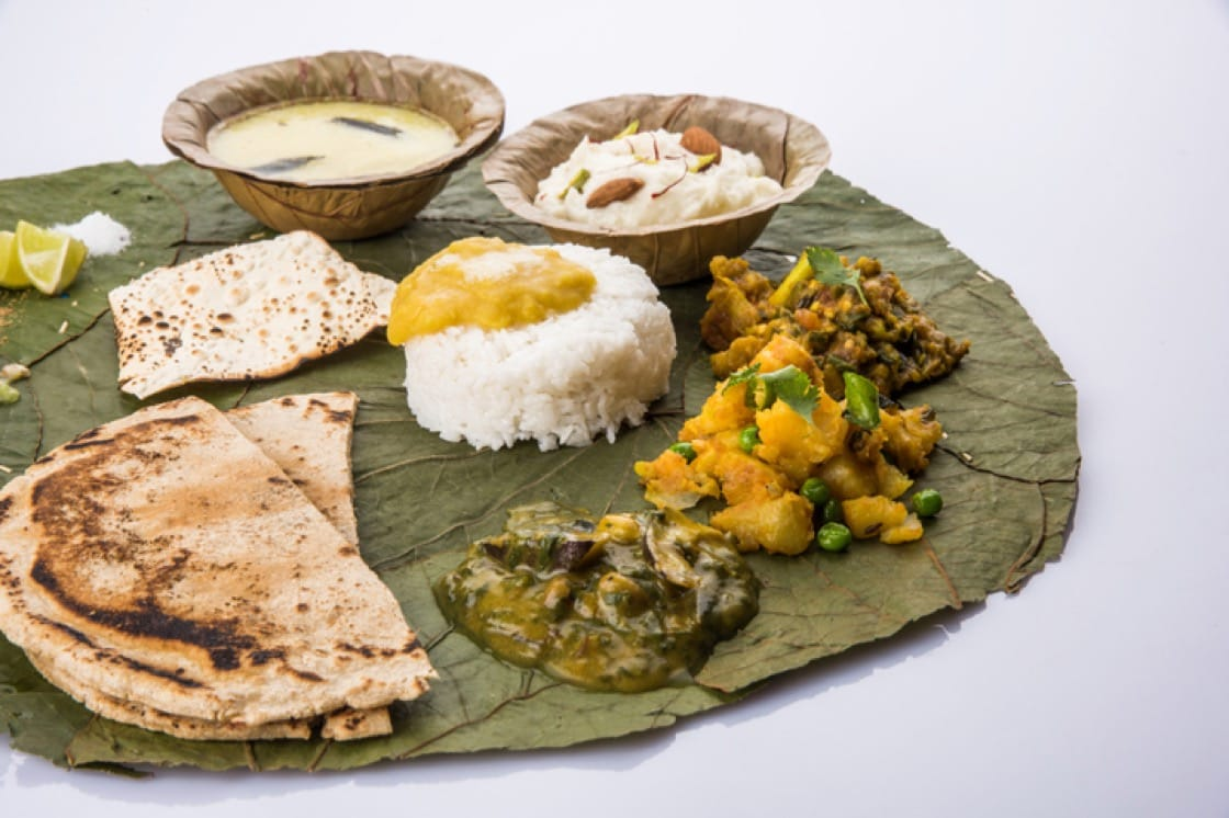 Typical Maharashtrian food served in plates and bowls made from leaves