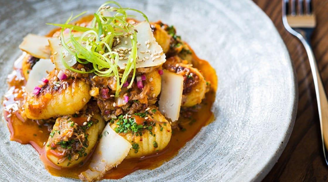 "The ""Gnocchi Bokki"" at Hazel, served with pork-kimchi ragú, sesame seeds and smoked Pecorino."
