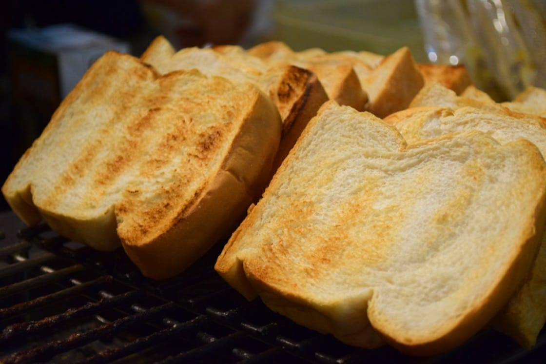 Freshly charred, thick slices of toast