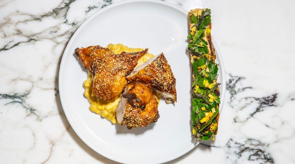 Roasted half chicken with mustard, pâté toast and sweet corn from Marisol. Photo Credit: Jeff Marini.