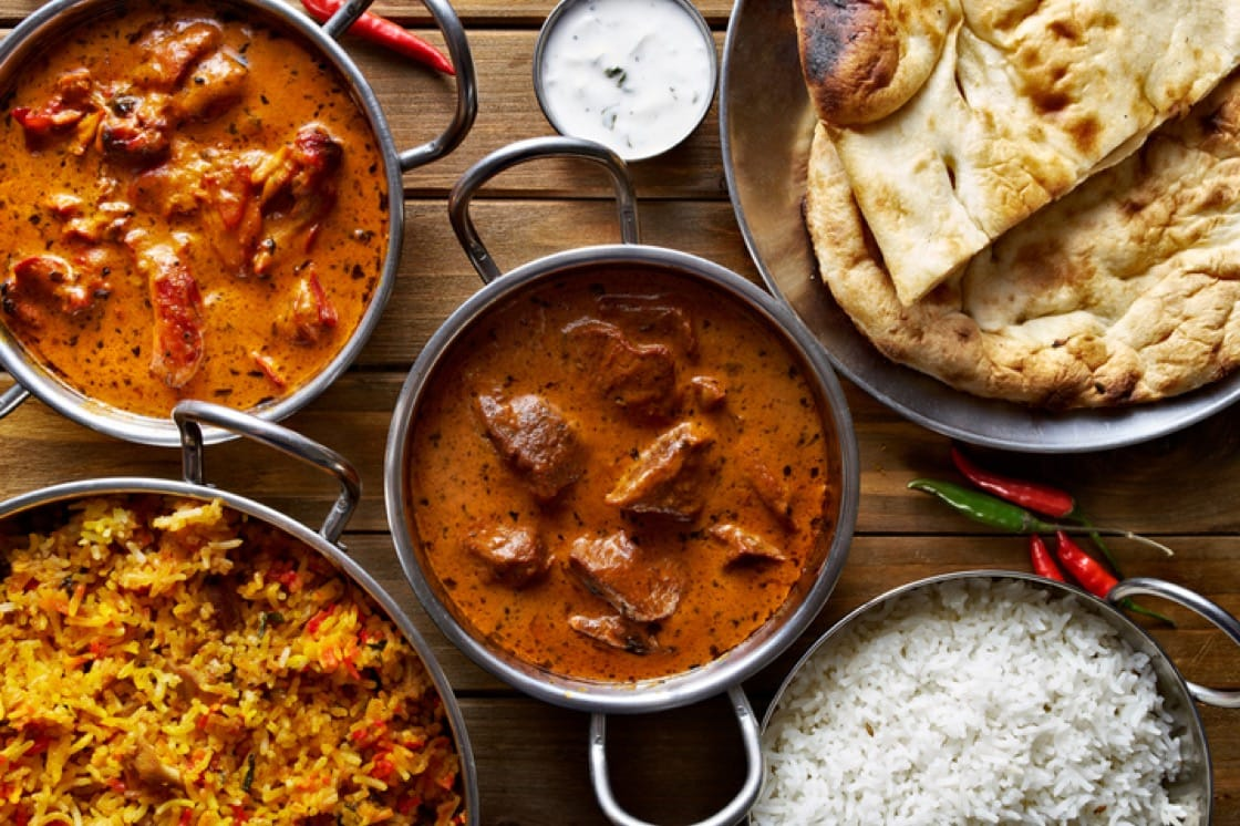 Spread of dishes, from tikka chicken marsala and butter chicken to briyani rice and naan