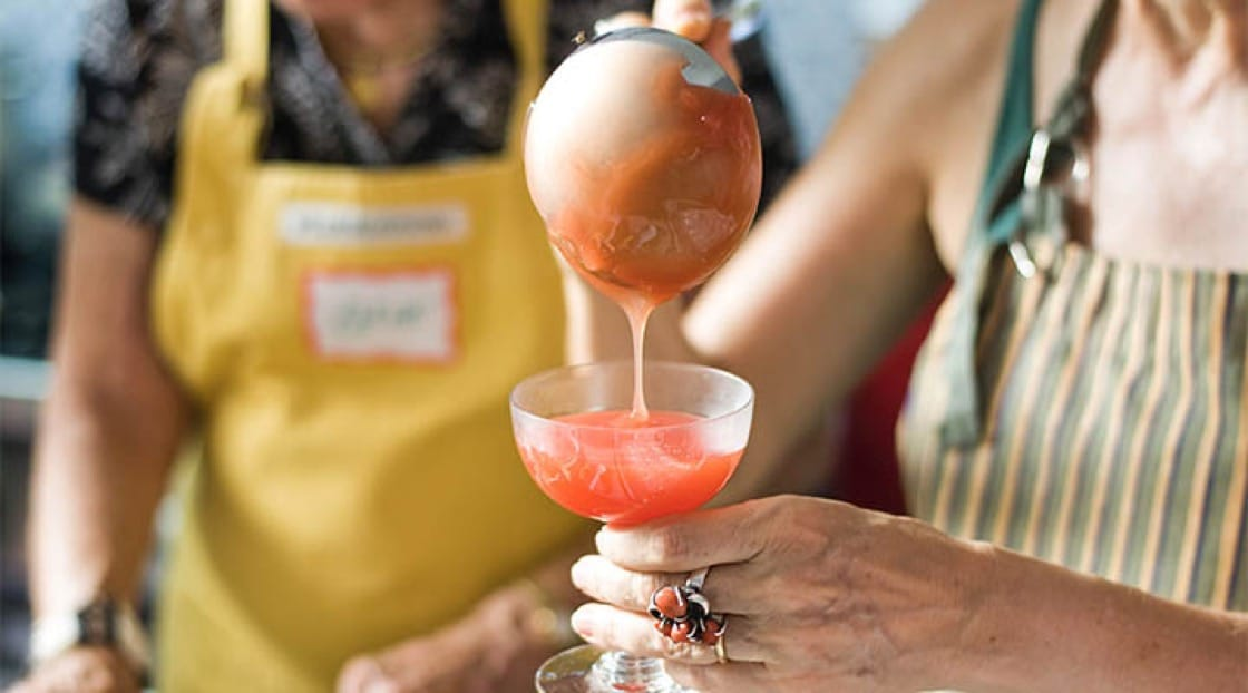The Duchess pours gelo di mellone—or, watermelon pudding—into a Champagne glass before letting it sit in the fridge to set.