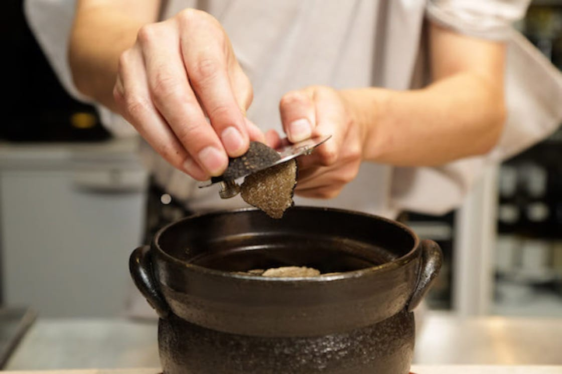 Black truffle shavings over Kamoshita's seasonal sea bream claypot rice.