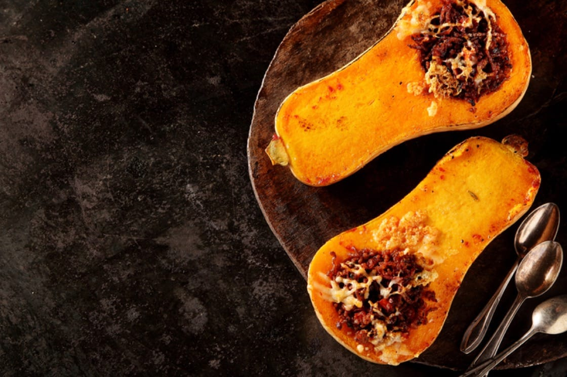 Halved, stuffed and roasted butternut squash