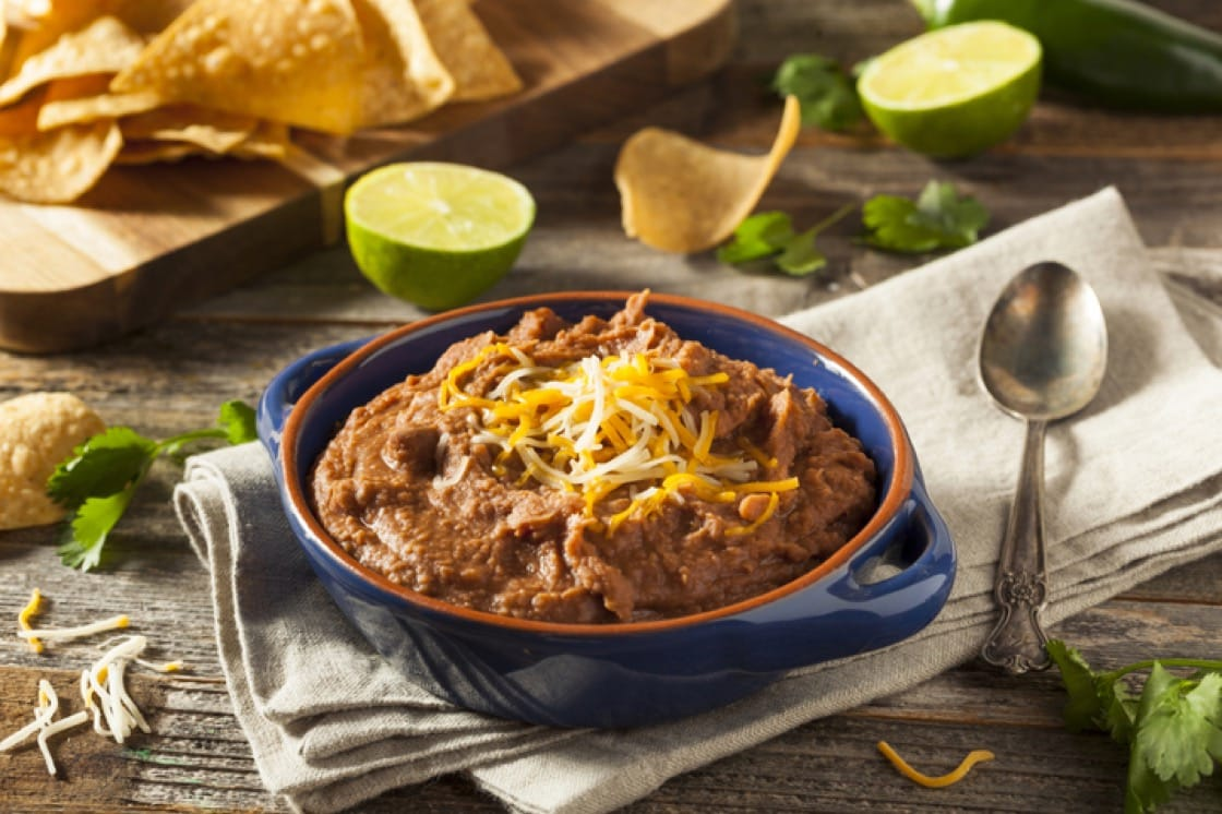 Refried beans: a traditional staple of Mexican and Tex-Mex cuisine.