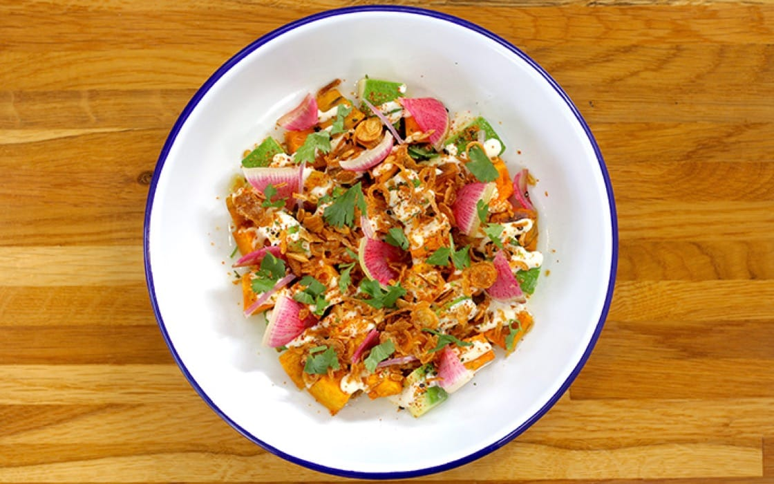 Roasted sweet potato and avocado with crispy onion, lime, radish and cilantro.