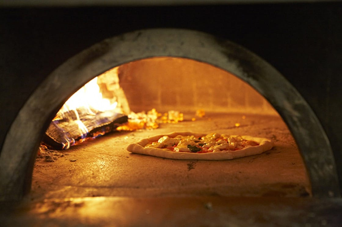 The signature pies at Don Antonio by Starita are finished in a wood-fired oven. (Photo courtesy of Don Antonio by Starita.)