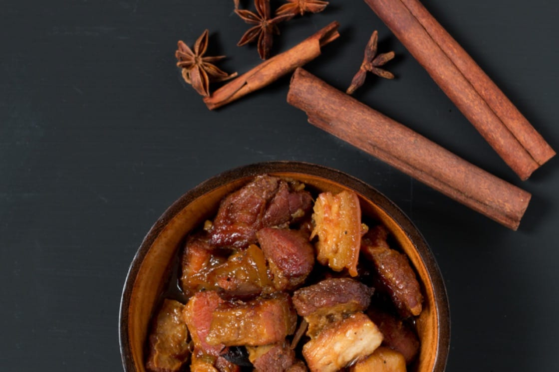 Braised pork belly with star anise and cinnamon.