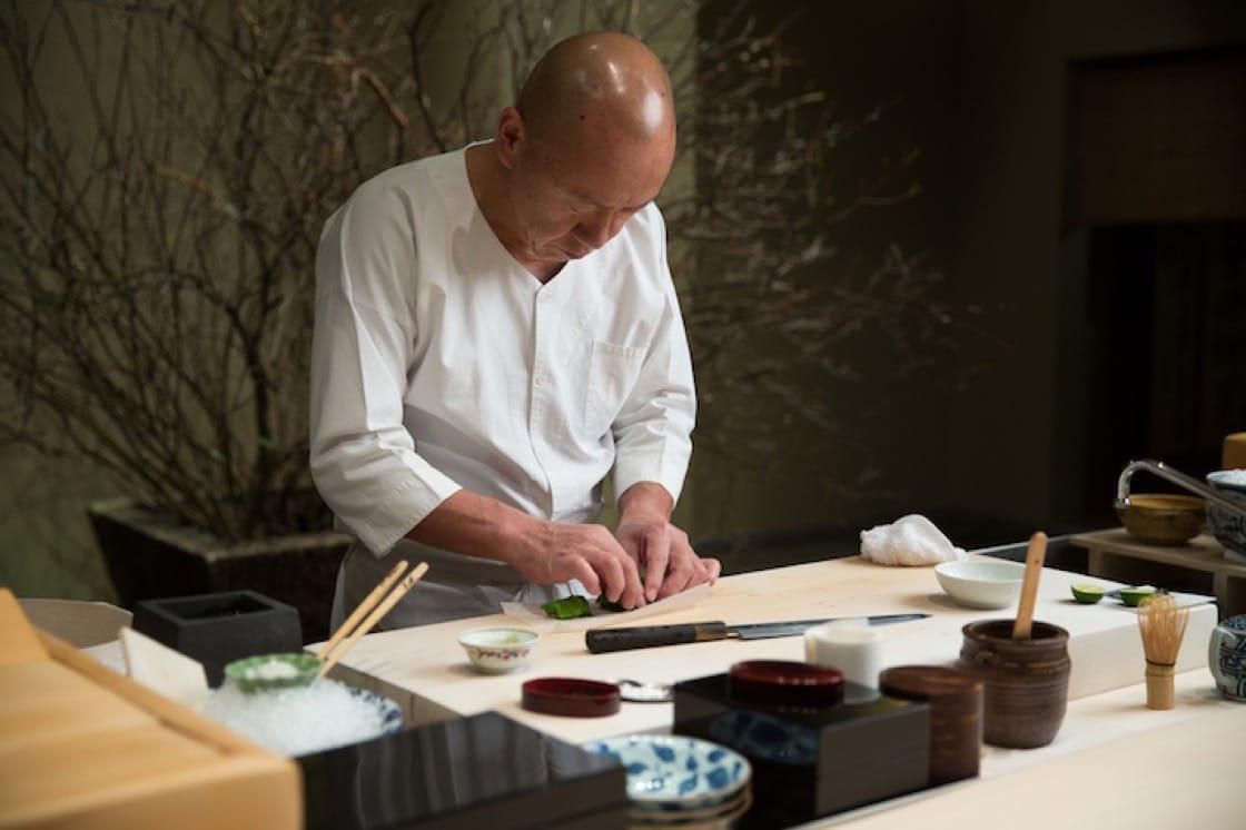 Chef Masa Takayama behind the sushi counter at Masa in NYC's Time Warner Center.