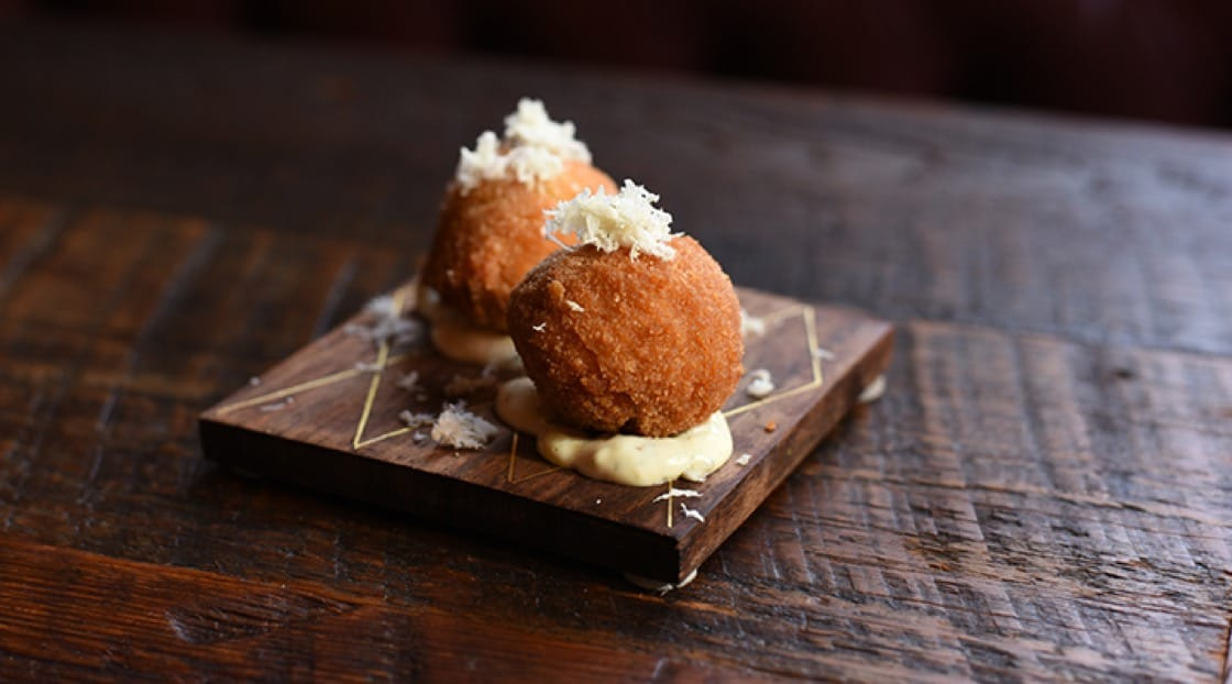 Food offerings include gefilte croquettes (pictured), smoked tongue sliders, mini stuffed cabbage, and more.