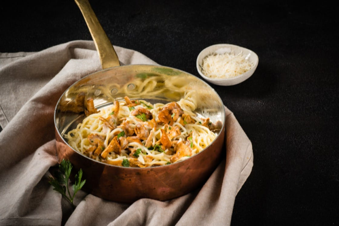 Chanterelle mushrooms lightly toasted in a pan then tossed in a tangle of pasta, herbs and cream.
