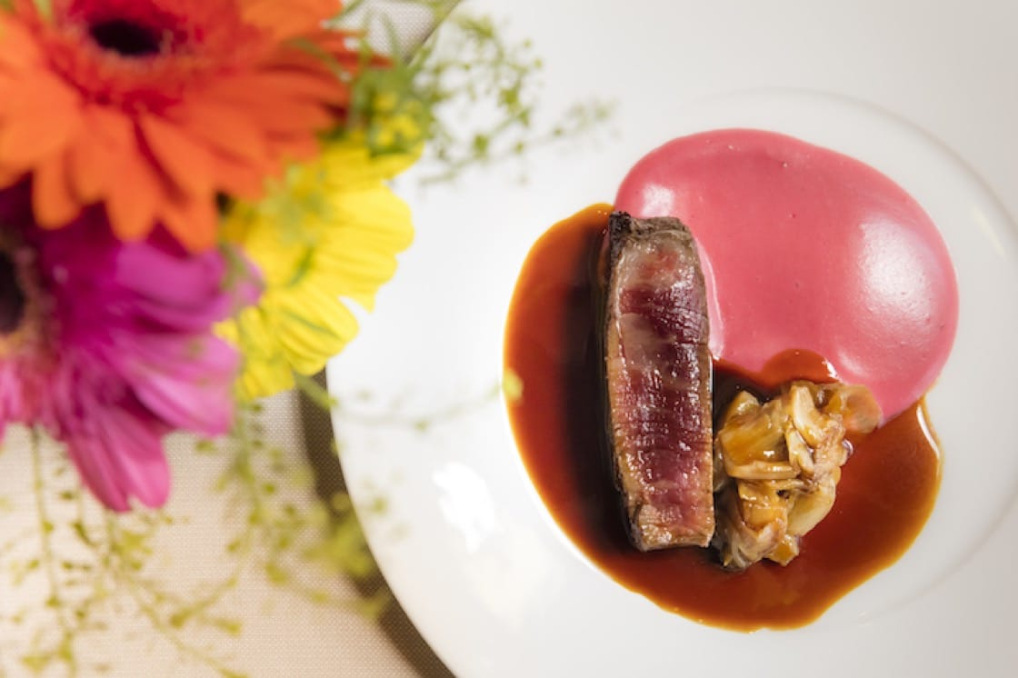 Wagyu tenderloin with candied chicory, creamy beet and potatoes soufflé bigarade sauce.