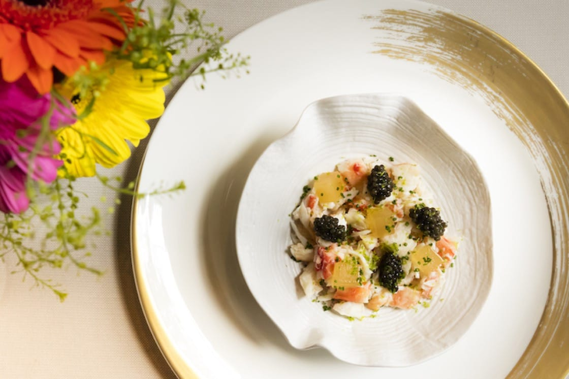 King crab with shrimp consommé jelly, Russian caviar and zest of lime.
