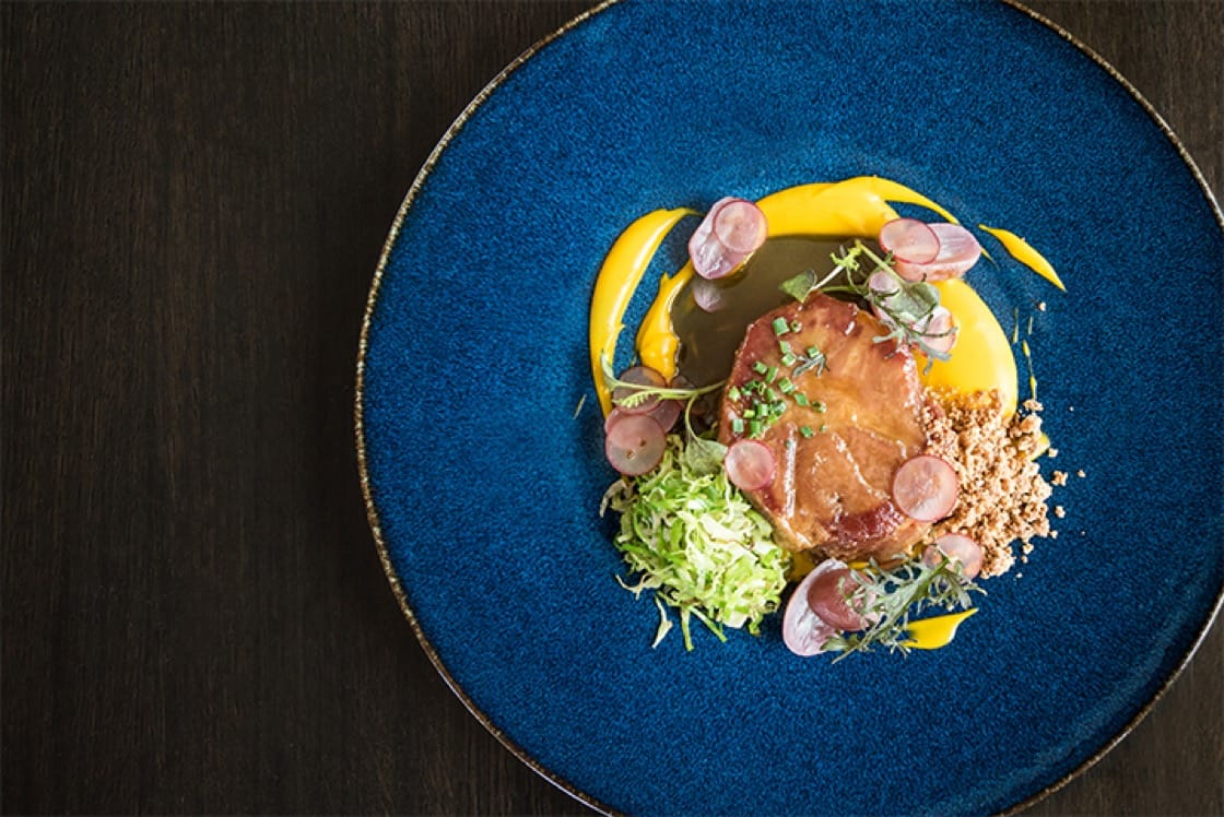 Pork collar with sweet potatoes, grapes and Brussels sprouts. (Credit: Kailley Lindman.)