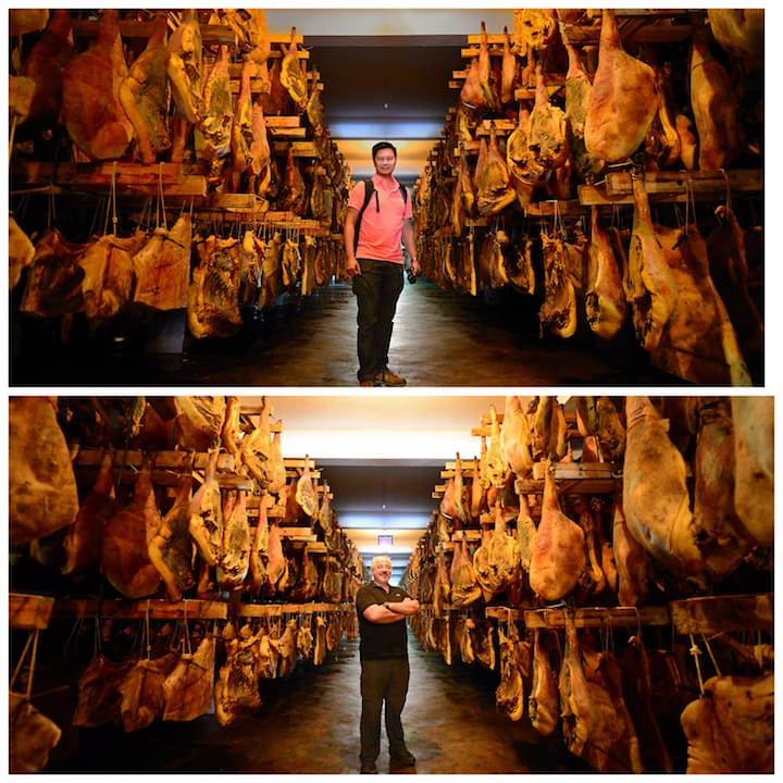 笔者及米芝莲三星食肆的意大利大厨Umberto Bombana 于存腿过万的存储发酵房。 (摄影:邬智明)