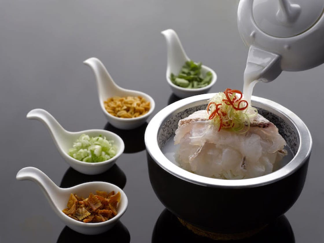 This dish of Dong Xing Garoupa Rice, Crispy Rice in Superior Stock is served in a hot stone bowl inspired by Korean bibimbap.