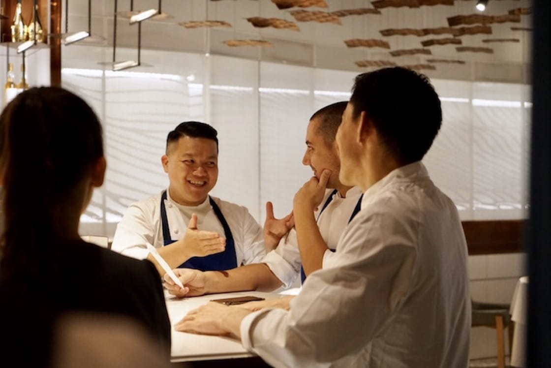 (From left) Kai Ho, Julien Royer and Hideaki Sato in the pre-dinner briefing session, in preparation for the night's six-hands dinner. (Photo by Liz Kao)