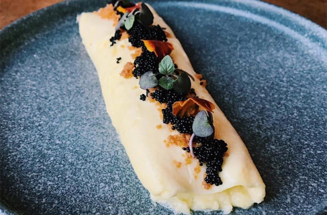 "One of his favorite dishes is ""Eggs on Eggs,"" which is a French omelet with Osetra caviar and brown butter crumble. (Photo courtesy of Band of Bohemia.)"