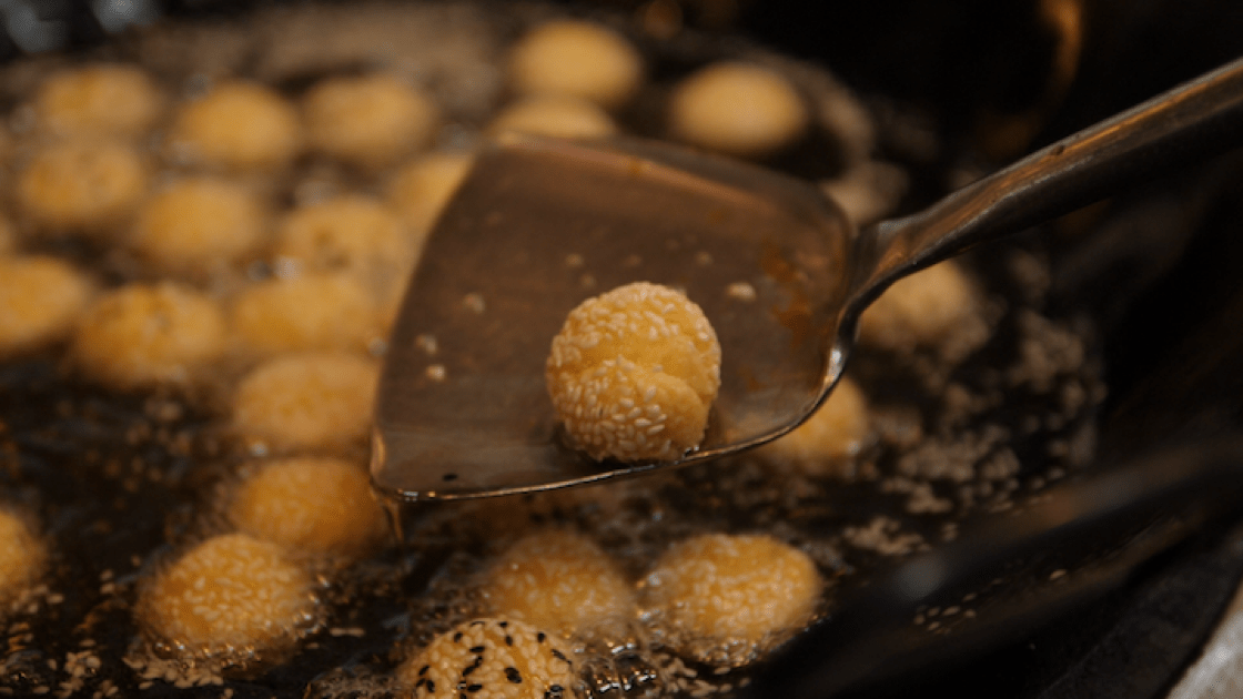 """When sesame balls are cooked through, they'll split open into """"smiles""""."""