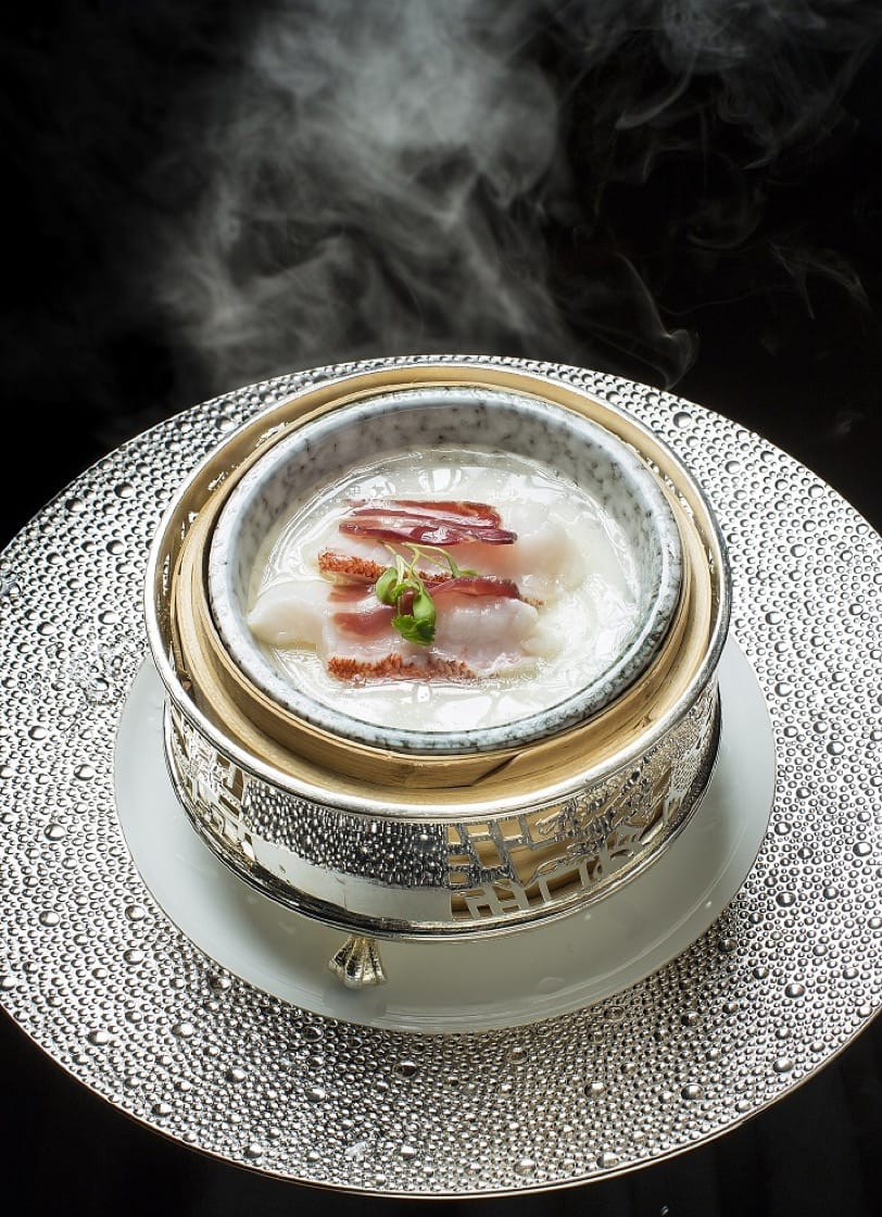 Chef Tam's steamed sliced garoupa with egg white custard and aged 'Huadiao' wine will be featured on the 4-hands menu. (Photo credit: City of Dreams)