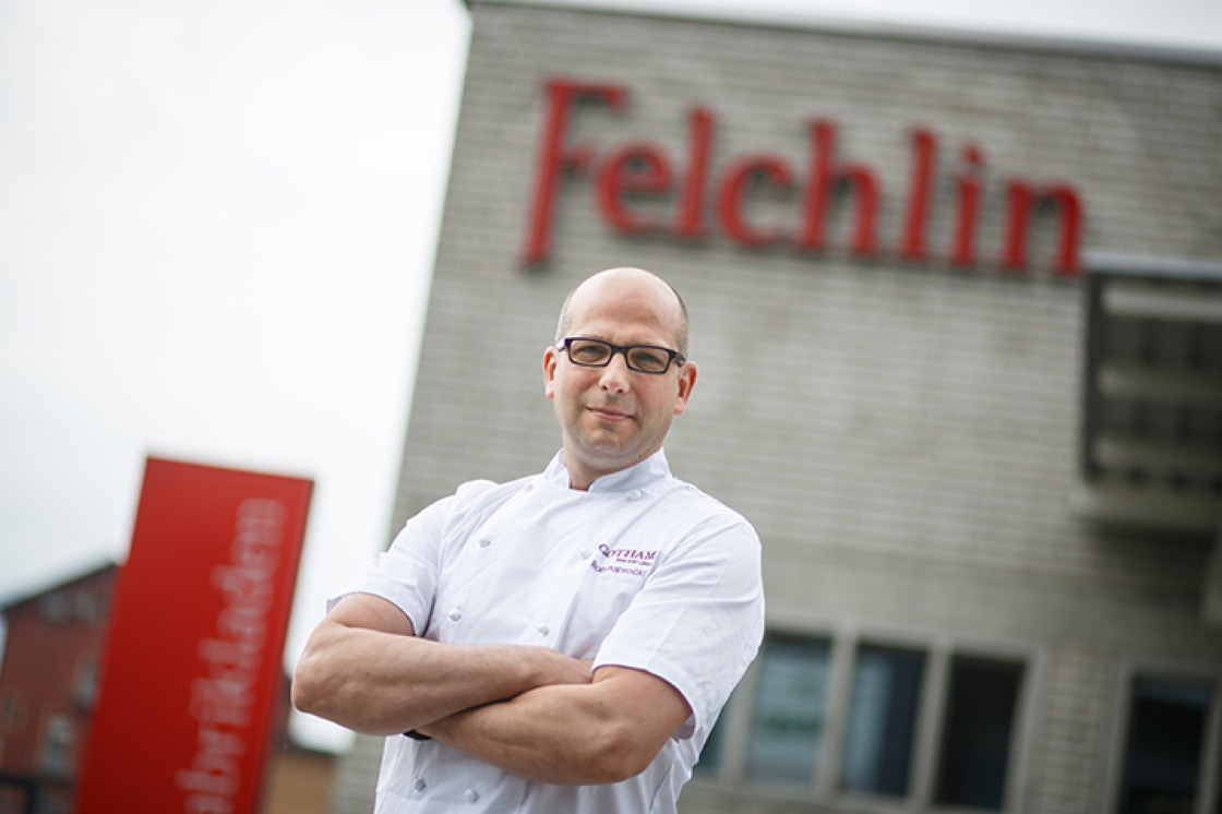 Ron Poprocki outside of the Felchlin chocolate factory in Switzerland. (Photo: Gotham Bar and Grill.)