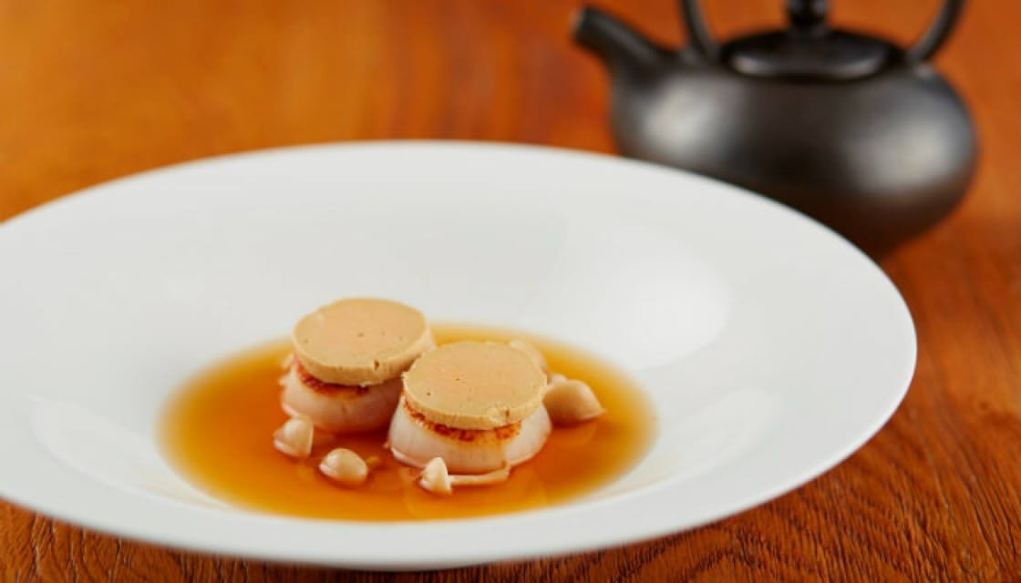 <p><b>Love at First Bite:</b> The combination of <b><i> Hokkaido scallops and foie gras</b></i>  in itself is not new; it is widely popular, which is proof of a great pairing. But here, the chef takes it to another level with shimeji-scented miso consomme, a clear but bold statement of Japanese flavor.  <p>Elements - 25th floor at The Okura Prestige Bangkok, Wireless Road, 02-687-9000, Tues - Saturday 18:00 -22:30</p>