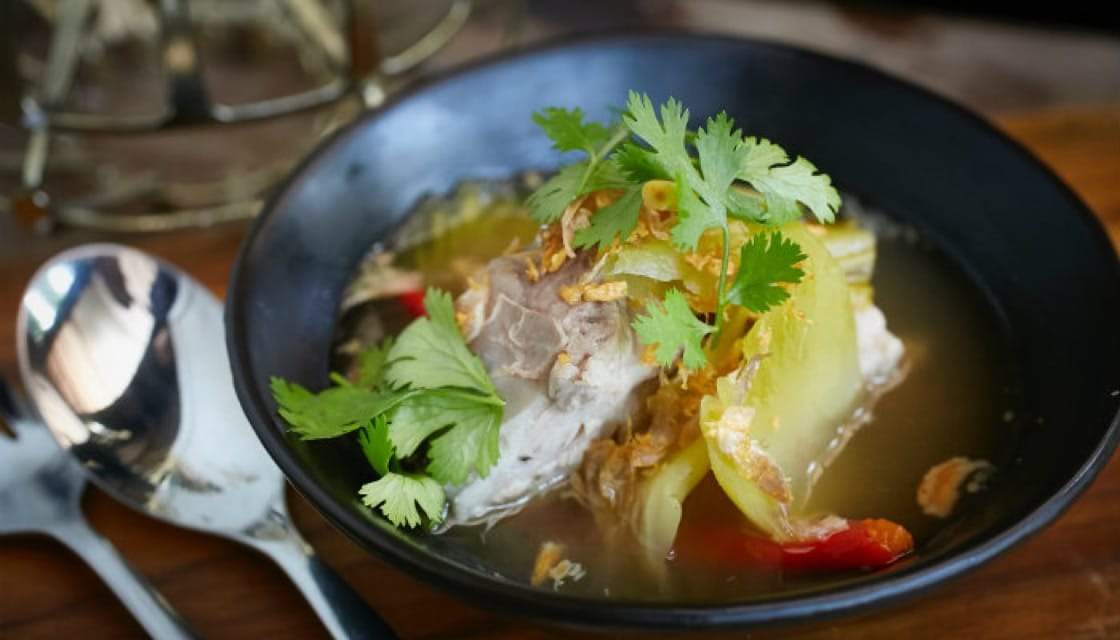 <p><b>Love at First Bite</b>: The <b><i>hot and sour soup</b></i> of house pickled pak song mustard greens with young pork ribs and ocean fish is served with pickled vegetables. The mild spiciness and memorable combination of ingredients make this a truly comforting dish.</p> <p> Bo.lan - Sukhumvit Soi 53, Bangkok, 02-260-2962, Sat-Sun noon-14:30,  Tue-Sun 18:00-01.00 (last order 22.30) </p>