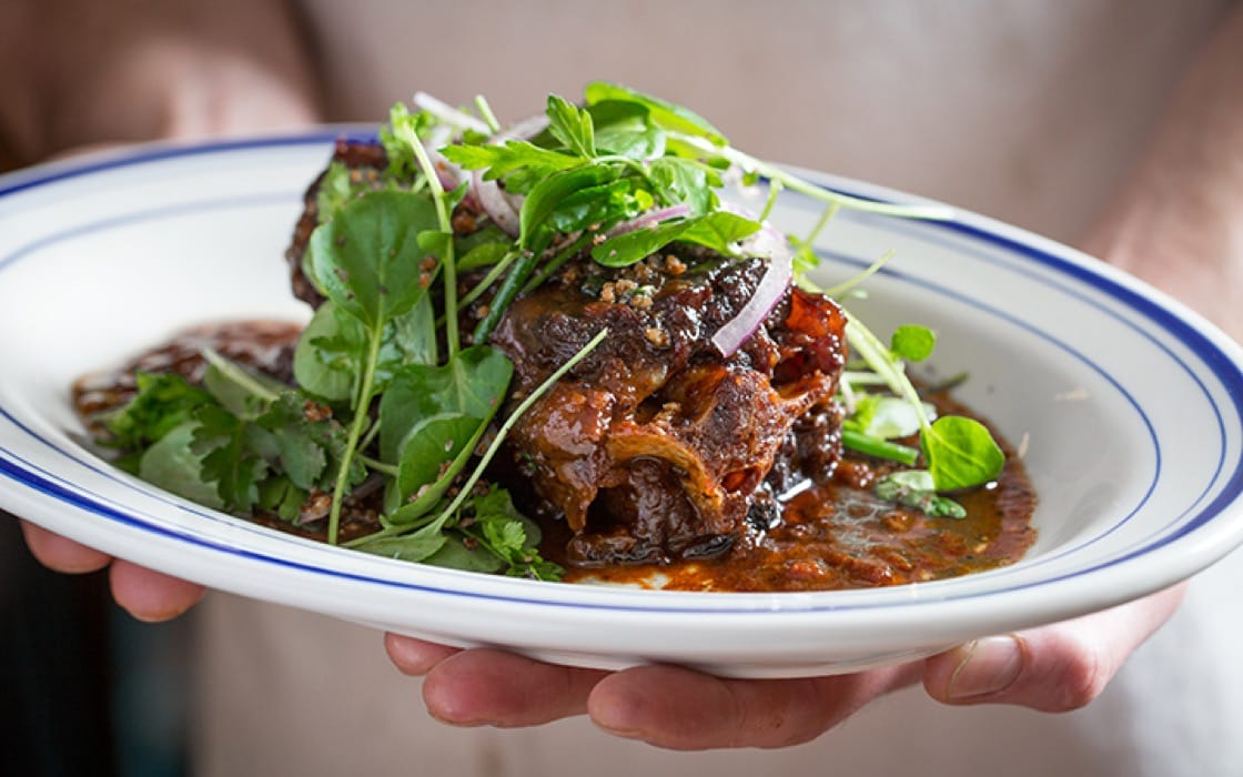 Bar Biscay's whole oxtail with watercress and orange gremolata. (Photo: Galdones Photography.)