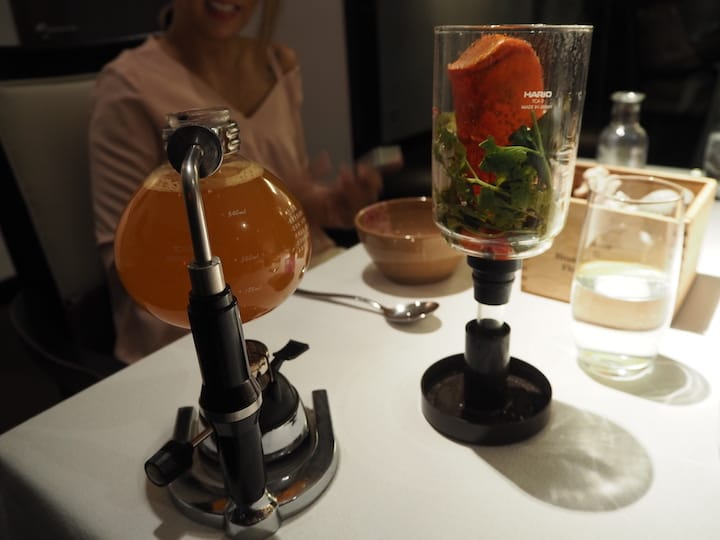 Rasam is served bubbling in a siphon coffee brewer that offers a slice of theatrics. (Photo: Kenneth Goh)