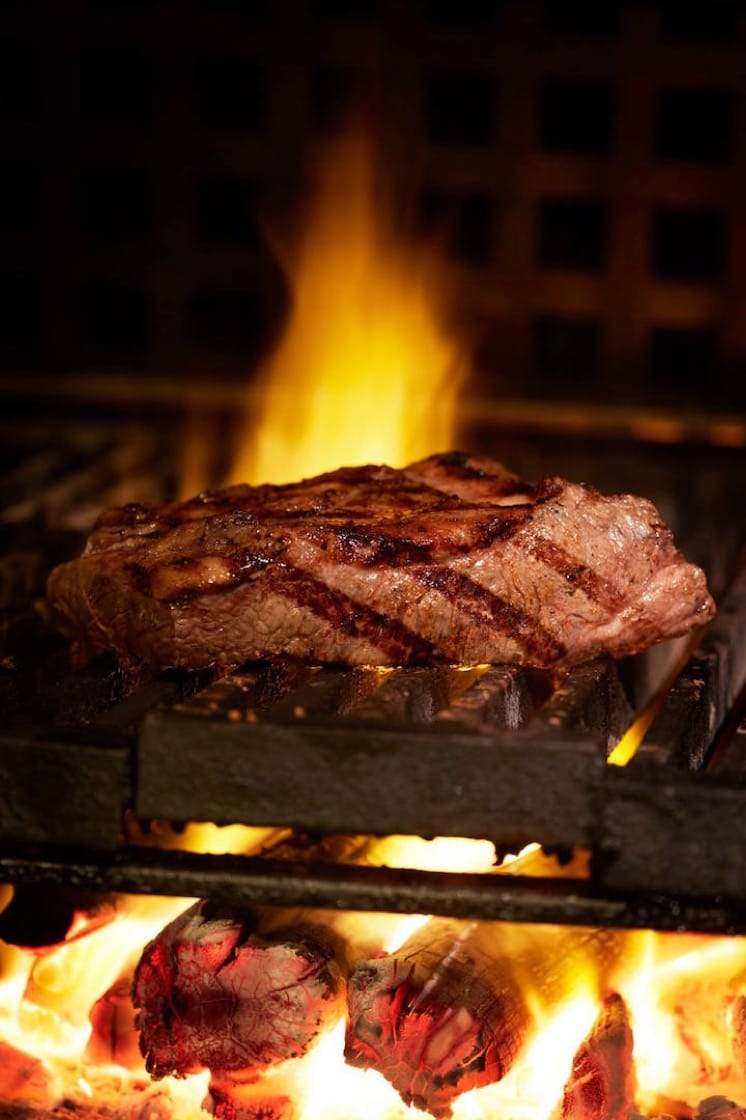 The steak at the Steak House winebar + grill is cooked on charcoal until it reaches the desired doneness.