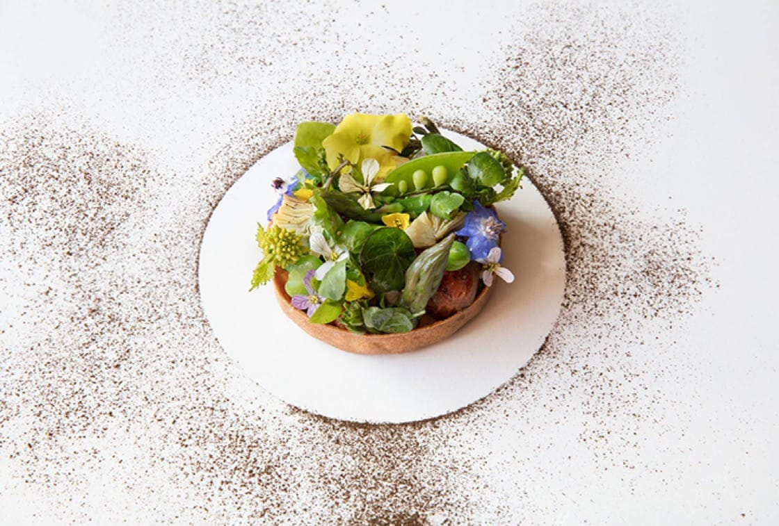 Also new to the menu: this buckwheat and spring vegetable crostata with Bufala mozzarella and artichokes. (Photo: Acquerello Facebook)