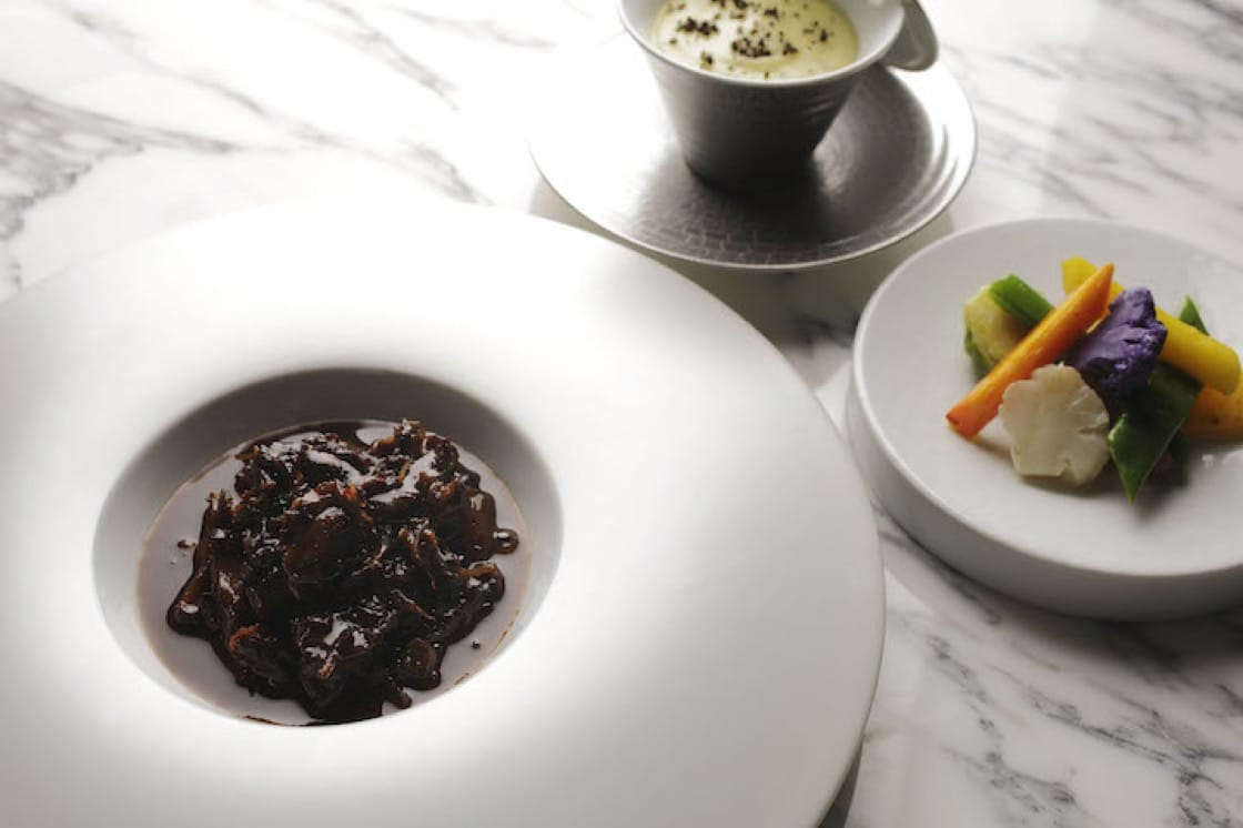 Bouchet says this dish of slow-cooked oxtail with mashed potato and black truffle encapsulates his culinary philosophy.