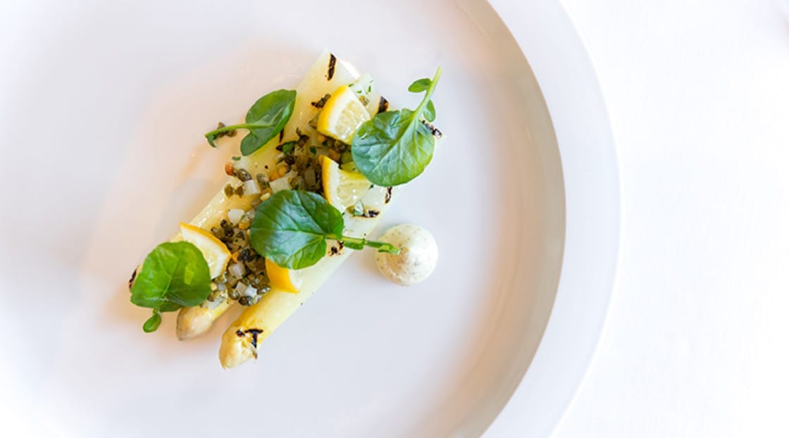 Grilled white asparagus with preserved meyer lemon, watercress and pine nut-caper relish from The French Laundry.