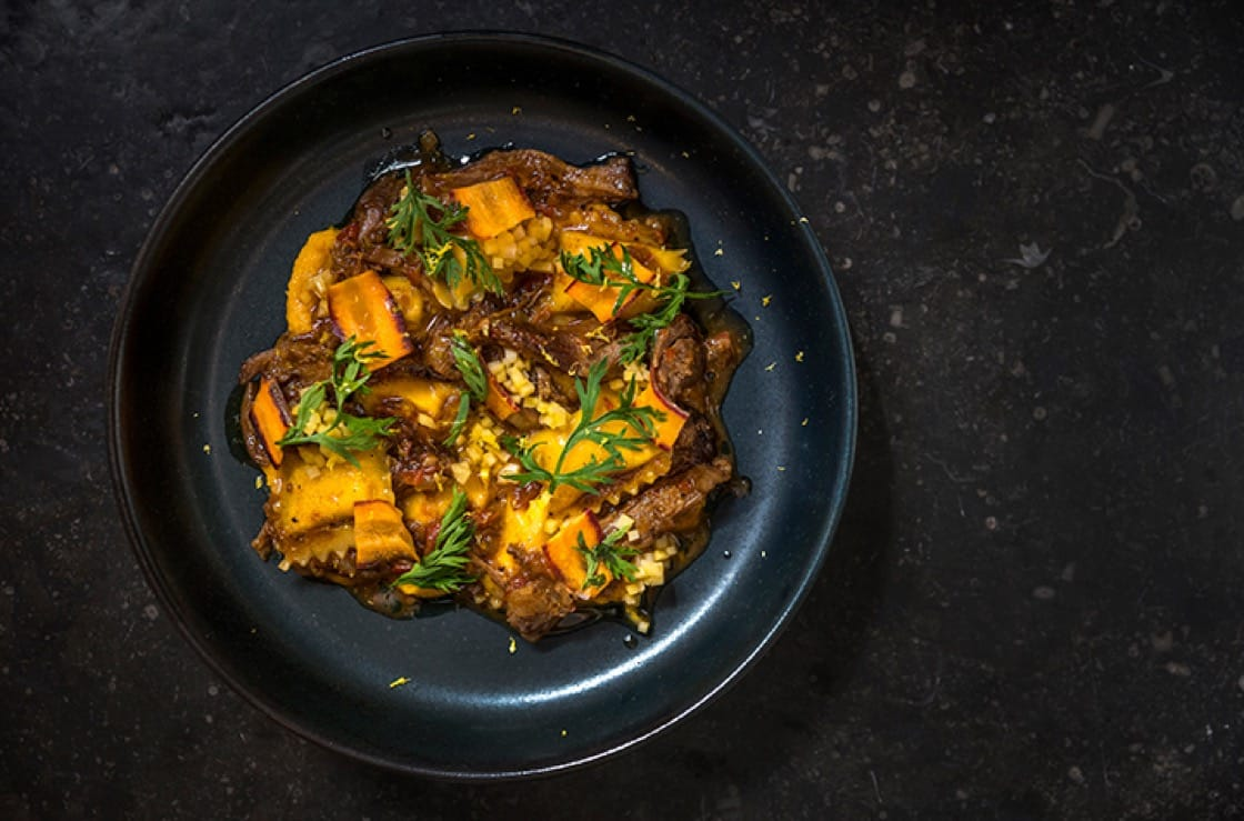 Carrot agnolotti with lamb neck and pickled squash. (Photo courtesy of Ferris.)