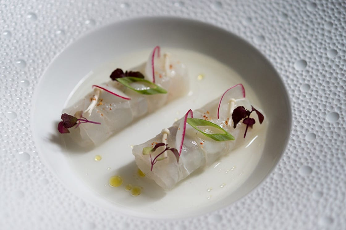 "Fluke and enoki mushroom ""spring roll"" with Junmai and shiso-infused tomato water."