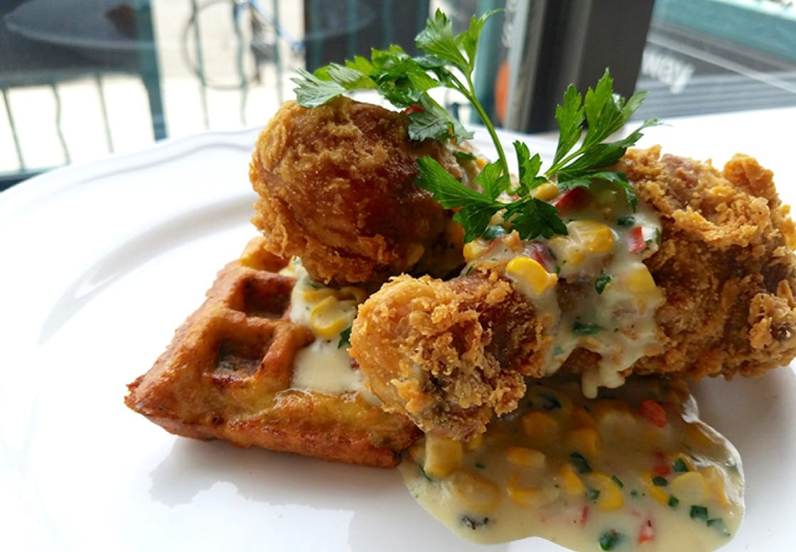 Amish-style fried chicken with potato waffles and corn creme.