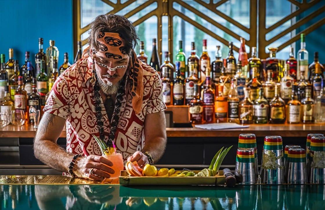 """Tiki Apostle"" Brian Miller behind the bar at The Polynesian."