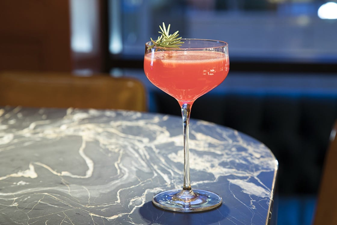 Meet the Metropolitan, a bright concoction of Ford's gin, Italicus Rosolio de Bergamotto, lemon, cranberry, orange marmalade and rosemary. (Photo by Robyn Lehr.)