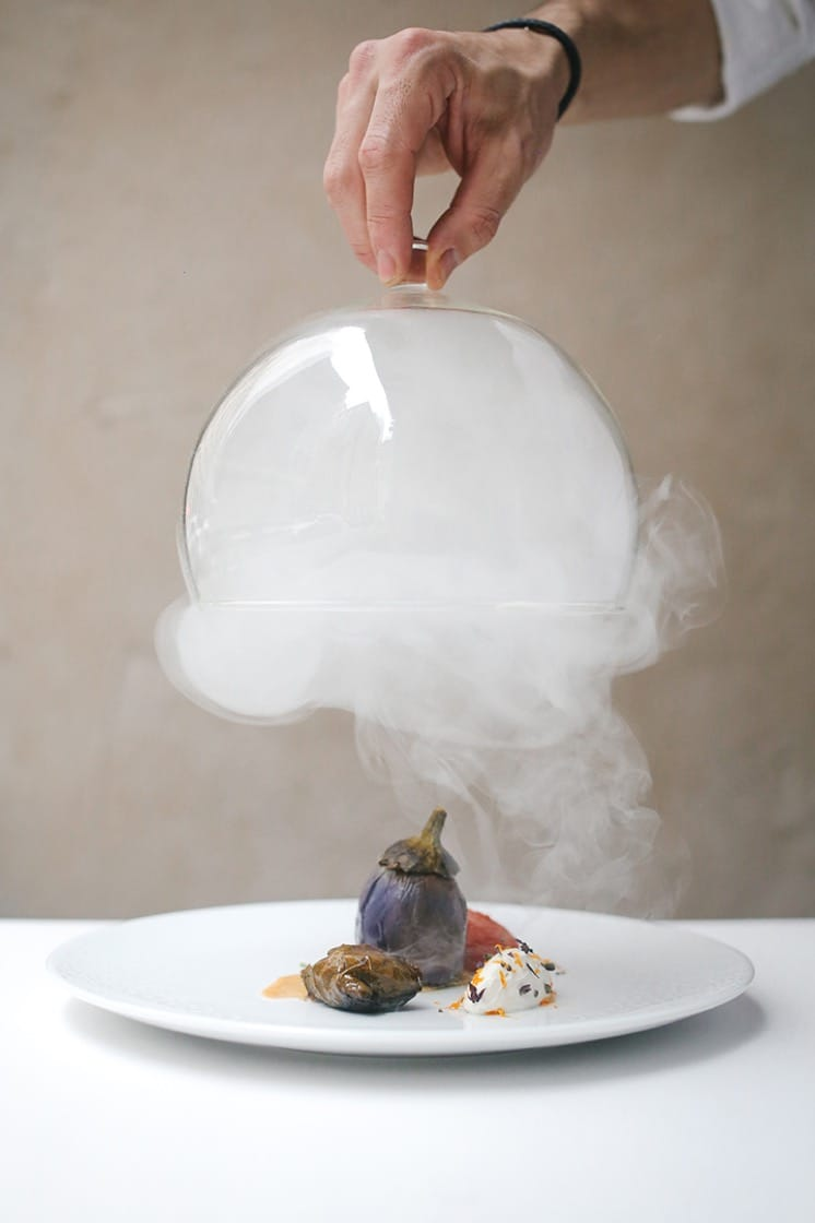 Smoked fairytale eggplant with tangerine labneh, chicken oyster and tomato conserva.