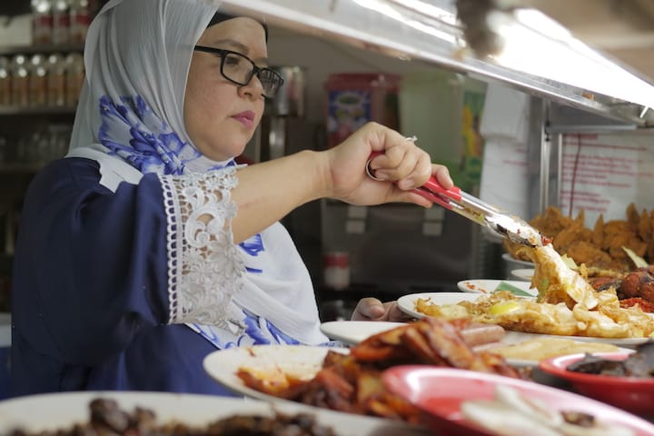 Hafidah took over her mother's humble army camp food stall at a young age.